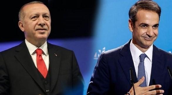 رئيس الوزراء اليوناني كيرياكوس ميتسوتاكيس والرئيس التركي رجب طيب أردوغان (أرشيف)