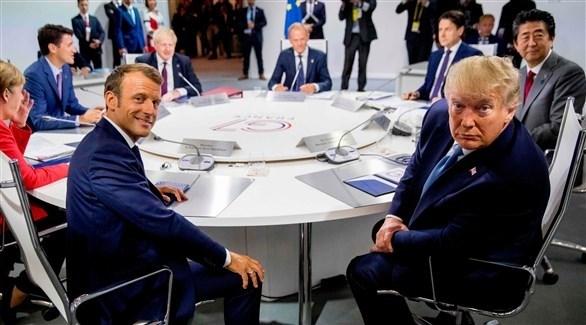 الرئيسان الأمريكي دونالد ترامب والفرنسي على طاولة زعماء مجموعة السبع في بياريتز (أ ب)