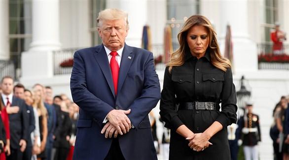 الرئيس الأمريكي دونالد ترامب  وزوجته ميلانيا في مراسم إحياء ذكرى 11 سبتمبر اليوم (رويترز)