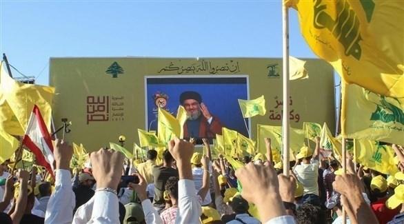 مناصرو حزب الله يستمعون إلى خطاب زعيم التنظيم الإرهابي (أرشيف)