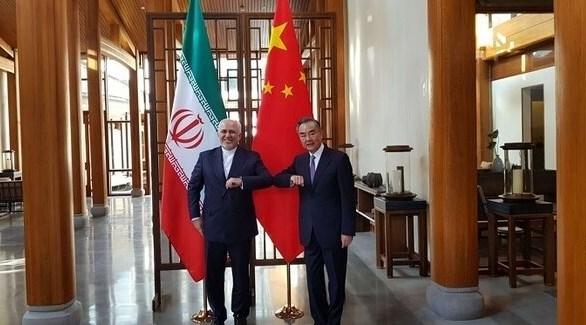 وزير الخارجية الإيراني نظيره الصيني (أ ب)