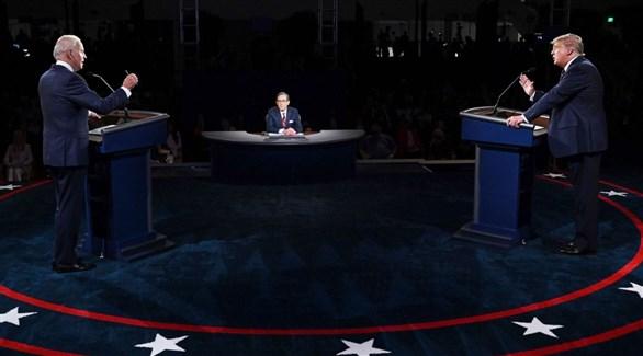 الرئيس الأمريكي دونالد ترامب ومنافسه جو بايدن في مناظرتهما الأولى (أيه بي سي)
