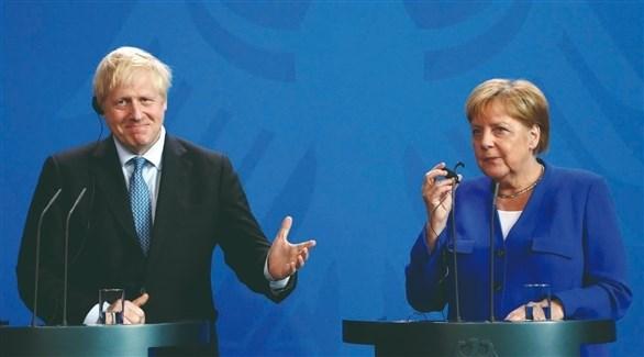رئيس الوزراء البريطاني بوريس جونسون والمستشارة الألمانية أنجيلا ميركل (أرشيف)