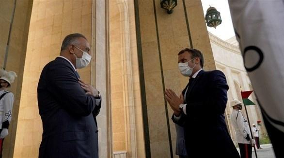 الرئيس الفرنسي إيمانويل ماكرون ورئيس الوزراء العراقي مصطفى الكاظمي (أرشيف)