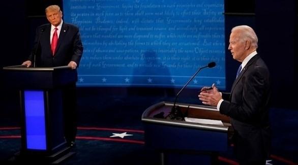 الرئيس الأمريكي دونالد ترامب والمرشح الديمقراطي جو بادين في المناظرة التلفزيونية (تويتر)