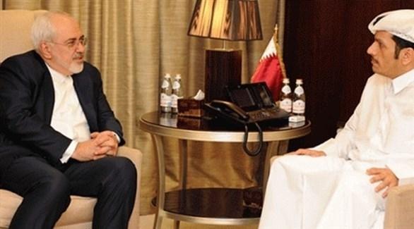 وزيرا الخارجية القطري محمد بن عبد الرحمن آل ثاني والإيراني جواد ظريف (أرشيف)