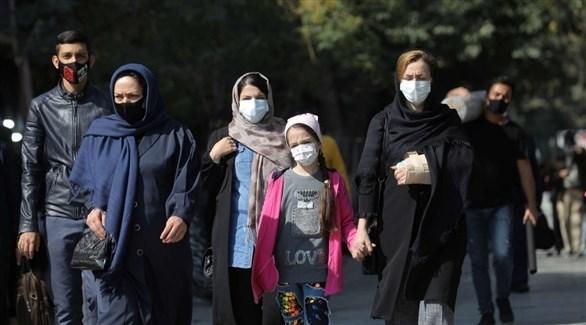 مواطنات إيرانيات يرتدين الكمامة للوقاية من كورونا (أرشيف)
