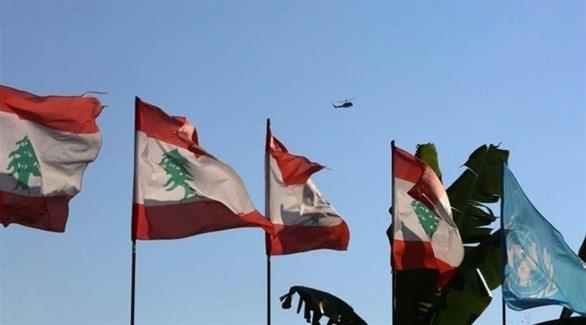 أعلام لبنانية عند نقطة حدودية مع إسرائيل (أرشيف)