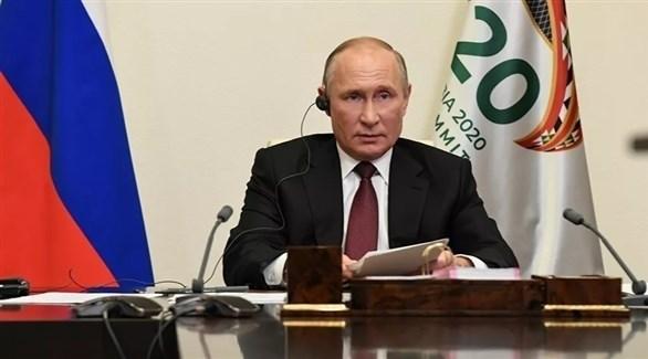 الرئيس الروسي فلاديمير بوتين خلال حديثه في قمة العشرين (تاس)