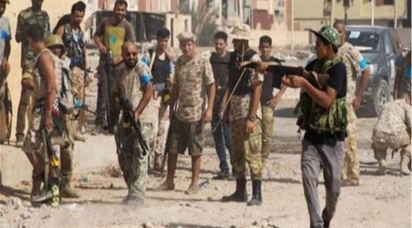 مسلحون من إحدى الميليشيات الليبية في طرابلس (أرشيف)