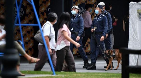 دورية لشرطة سنغافورة وسط المدينة (سترايت تايمز)