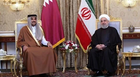 أمير قطر تميم بن حمد والرئيس الإيراني حسن روحاني (أرشيف)