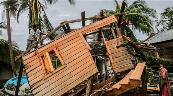 جانب من الأضرار التي خلفها الإعصار - أ ف ب