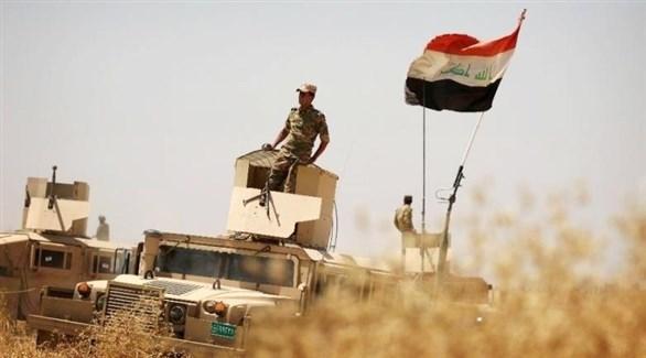جندي عراقي فوق مدرعة (أرشيف)