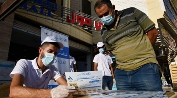 توزيع منشورات توعوية ضد كورونا في العراق (أرشيف)