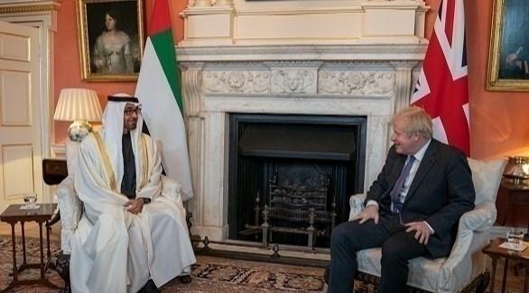 الشيخ محمد بن زايد آل نهيان خلال اجتماعه مع رئيس الحكومة البريطانية بوريس جونسون (أرشيف)