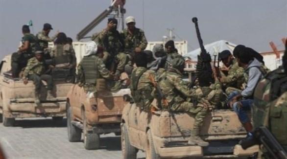 مسلحون في ميليشيات إيرانية بسوريا (أرشيف)
