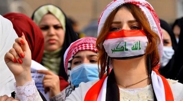 عراقيات يرتدين كمامات أثناء تظاهرات (أرشيف)