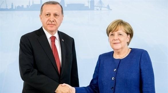 المستشارة الألمانية ميركل والرئيس التركي أردوغان (أرشيف)