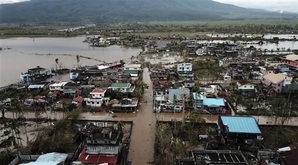 المياه تغمر شوارع في الفليبين جراء الإعصار (أ ف ب)