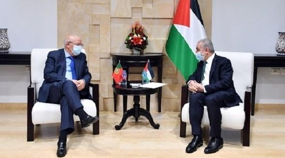 رئيس الوزراء الفلسطيني محمد اشتية ووزير خارجية البرتغال أوغوستو سيلفا (أرشيف)
