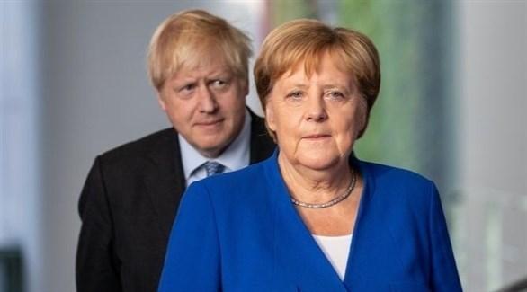 المستشارة الألمانية أنجيلا ميركل ورئيس الوزراء البريطاني بوريس جونسون (أرشيف)