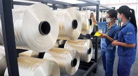 عاملتان في مصنع صيني (أرشيف)