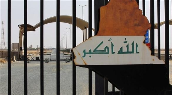 الخريطة العراقية على أحد البوابات الحدودية (رويترز)