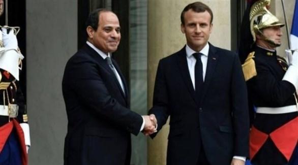 الرئيسان المصري عبد الفتاح السيسي والفرنسي إيمانويل ماكرون في قصر الإيليزيه (أرشيف)