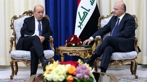 الرئيس العراقي برهم صالح ووزير الخارجية الفرنسي جان إيف لو دريان (أرشيف)