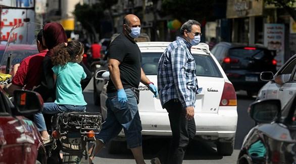 مصريون في أحد شوارع القاهرة (أرشيف)