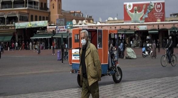 مغربي في ساحة جامع الفنا بمراكش (أ ف ب)