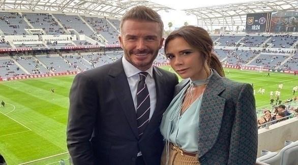 فيكتوريا مع زوجها ديفيد بيكهام (ذا صن)