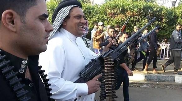 السلاح العشائري في إحدى المسيرات (أرشيف)