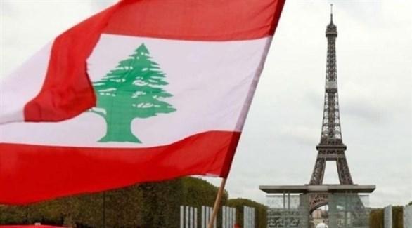 العلم اللبناني إلى جانب برج إيفل في باريس (أرشيف)