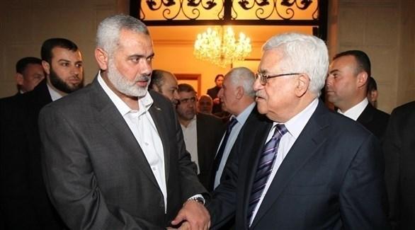 رئيس السلطة الفلسطينية محمود عباس وزعيم حماس إسماعيل هنية (أرشيف)