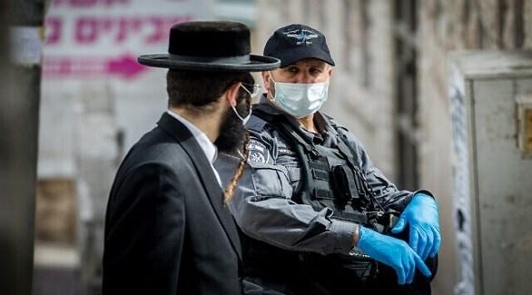 شرطي إسرئيل ومتشدد أرثوذكسي (تايمز أوف إسرائيل)