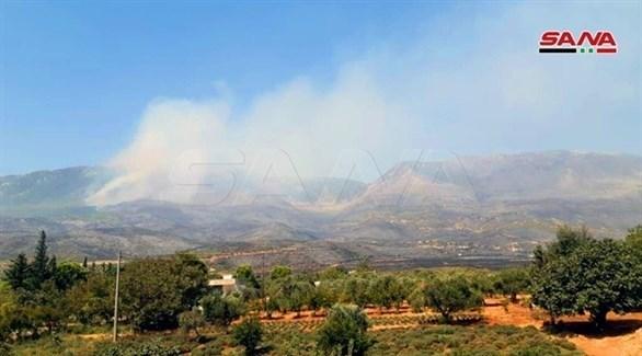 الدخان المتصاعد من الحرائق المستمرة (سانا)