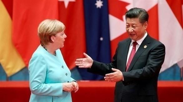 الرئيس الصيني  والمستشارة الألمانية (أرشيف)