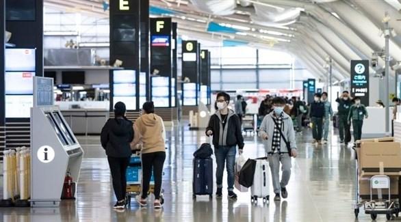 مسافرون في مطار طوكيو (أرشيف)