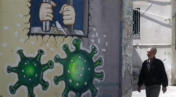 جدارية للتوعية من كورونا في غزة (أرشيف)