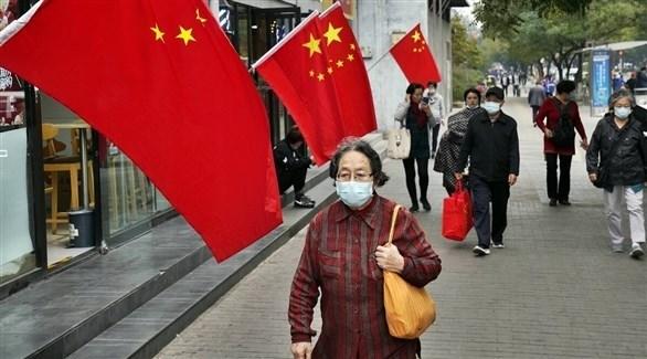 أشخاص يرتدون الكمامات في الصين (أرشيف)
