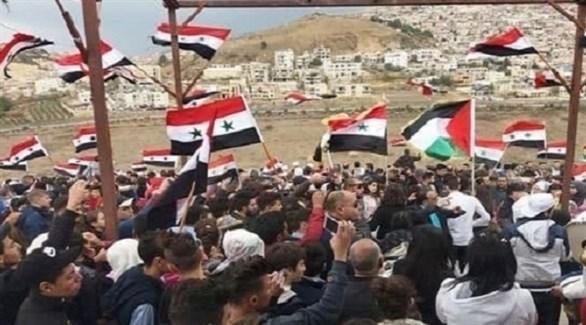 سوريون يحتفون بالمحررين العائدين من إسرائيل (سانا)