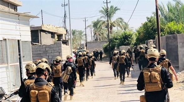 مقاتلون تابعون لميليشيات الحشد الشعبي في الطارمية السبت (تويتر)