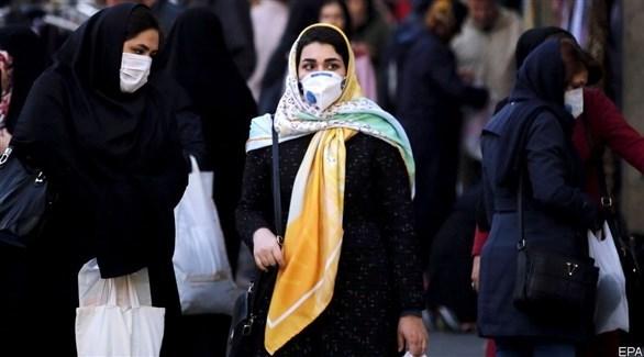 سيدات إيرانيات يرتدين الكمامة للوقاية من كورونا (أرشيف)
