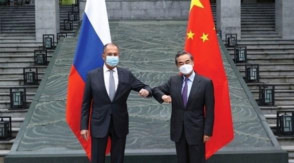وزيرا الخارجية الروسي لافروف والصيني وانغ يي (أرشيف)
