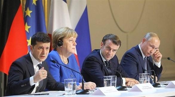 رؤساء أوكرانيا فولوديمير زيلينسكي وفرنسا إيمانويل ماكرون وروسيا فلاديمير بوتين والمستشارة الألمانية أنجيلا ميركل (أرشيف)