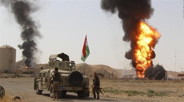 قوة كردية تطوق بئراً نفطياً بعد استهدافه من داعش (أرشيف)