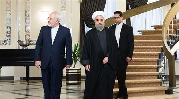 الرئيس الإيراني وبجانبه وزير خارجيته (أرشيف)
