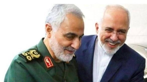 وزير الخارجية الإيراني محمد جواد ظريف وقائد الحرس الثوري الراحل قاسم سليماني (أرشيف)